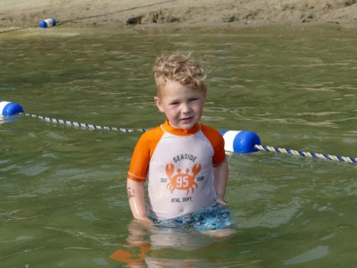 Lijah playing in the pond