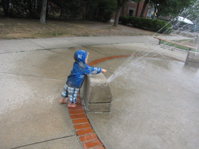 Lijah carefully poking at the fountain with a stick