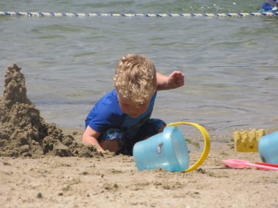 Lijah working on a sand castle