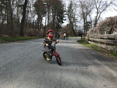 Lijah riding a two-wheeler for the first time