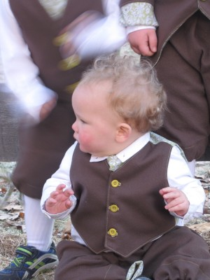 Lijah in his Easter suit, his brothers moving around behind him