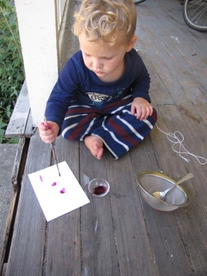 Lijah painting with pokeweed ink