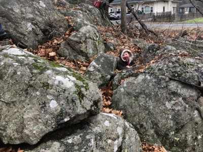 Elijah poking up from a hole in some rocks