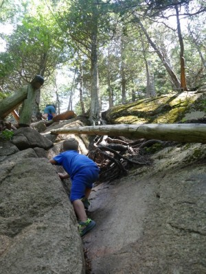 Lijah climbing up a steep part of the trail up Pemetic