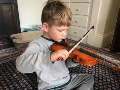 Lijah trying out a friend's violin