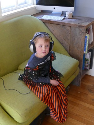 Lijah sitting on the couch wearing big headphones
