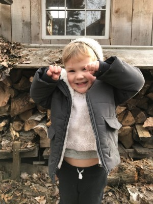 Lijah by the woodpile