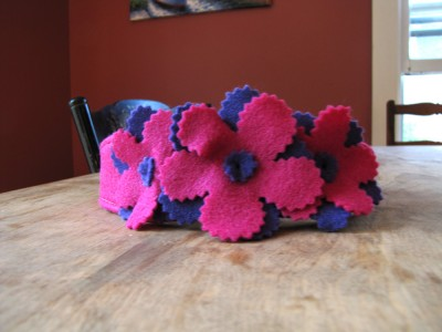 a headband in pink and purple flowers