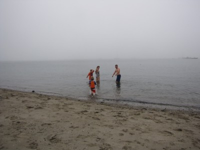 four of us in the water at foggy Lincolnville beach