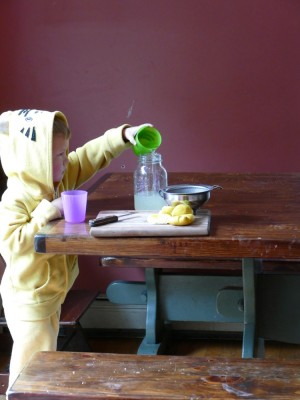 Lijah in lion sweatshirt making lemondade