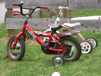 Zion's new bike: red 12-inch with training wheels
