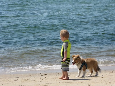 Lijah and puppy Tovi on the beach