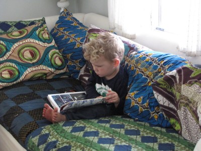 Lijah reading a book on the couch