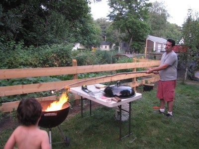 Samuel toasting a marshmallow on an 8-foot stick