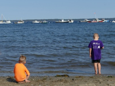 Zion and Lijah considering the water at the beach in Lincolnville