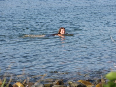 Leah swimming in the ocean