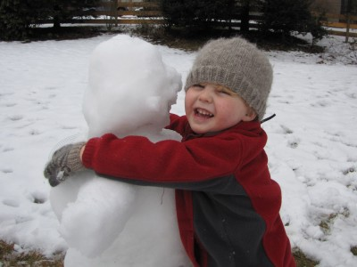 Harvey hugging his snowman