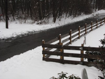 the fence standing up from wet snow