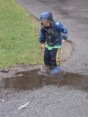 Zion jumping in a puddle