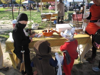 costumed boys trick-or-treating at the farmers market