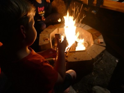 Zion toasting a marshmallow