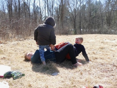 the boys wrestling in a meadow