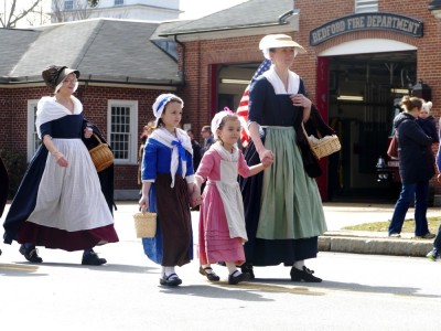 colonial women and girls walking in the parade
