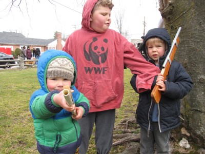 the boys posing on the green, Zion and Lijah with guns