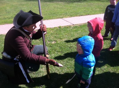 a reenactor offering to shake hands with Lijah and Zion