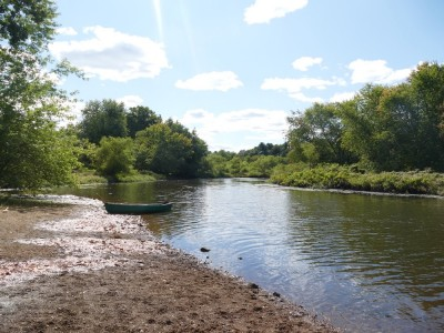 the canoe pulled up on a beach on the Sudbury River