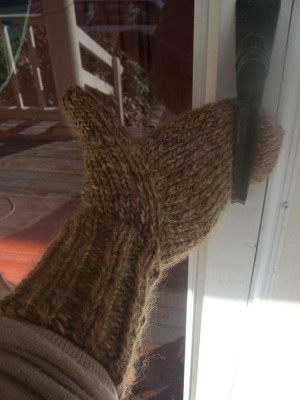 mitten reaching for the door
