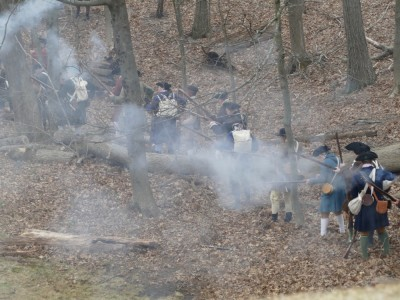 reenactors wreathed in gunsmoke in the woods
