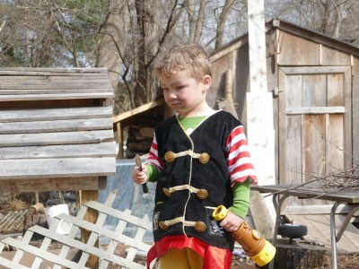 Lijah in the yard in his pirate costume