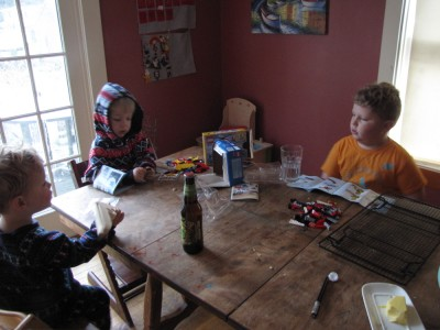 the three boys working on legos at the kitchen table