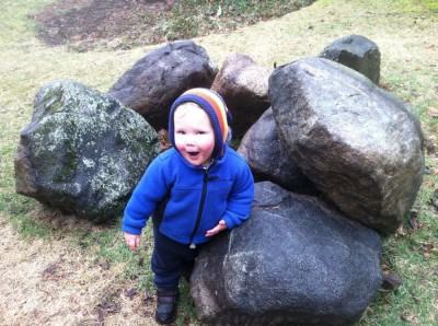 Lijah in his gnome hood amongst some big rocks