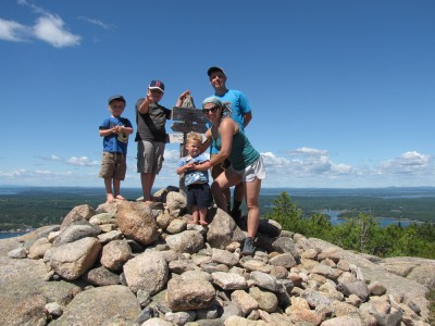 the Archibalds posing atop Parkman Mtn