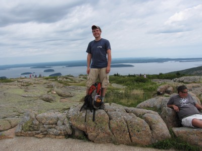 Dan standing on top of Cadillac Mtn, with Frenchmans Bay and the Schoodic Peninsula in the background
