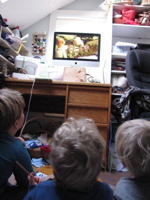 the boys watching a movie in the messy office/sewing room