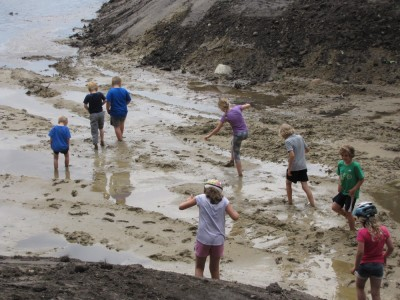 kids wading out into the mud
