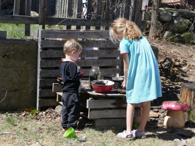 Lijah working in the mud kitchen with Havana