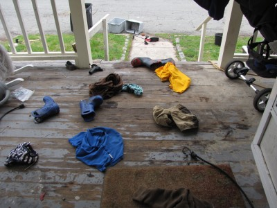muddy clothes scattered on the front porch