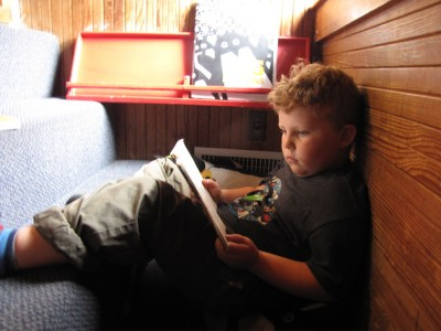 Harvey reading a book at the Childrens Discovery Museum