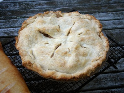 an apple pie cooling on the porch