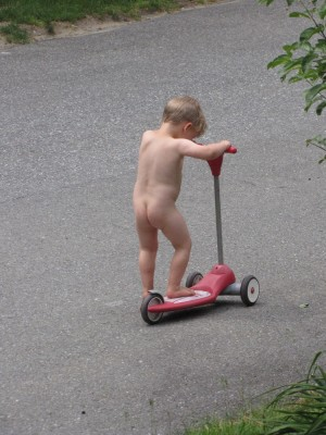 Lijah scootering naked in the street