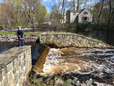 water pouring over the spillway from Warners Pond into Nashoba Brook