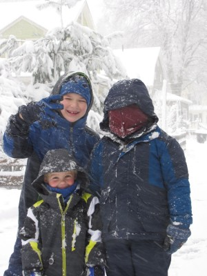Harvey, Zion, and a friend posing in the snow