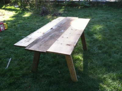 a picnic table made with scrap pine boards
