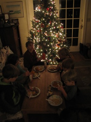 kids eating dinner at the playroom table in front of the Christmas tree