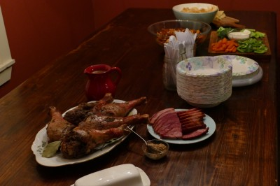 turkey drumsticks and other food on the table