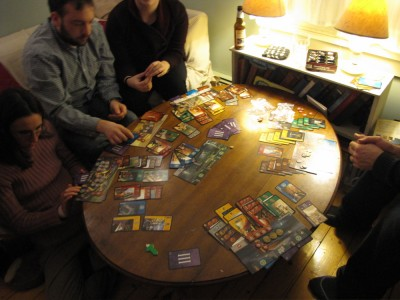 lots of colored cards on our coffee table: 7 Wonders